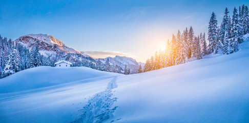 Wall Mural - Winter wonderland in the Alps with mountain chalet at sunset
