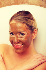 Happy woman with chocolate mask