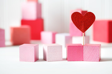 Red and pink wooden blocks with small heart