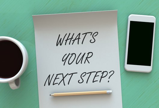 Whats Your Next Step, message on paper, smart phone and coffee on table