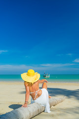 Woman on holidays relaxing by the coconut tree