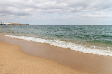 View of the sandy beach of the sea coast of Spain