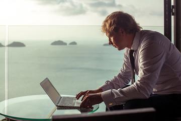 Smart businessman is working on laptop
