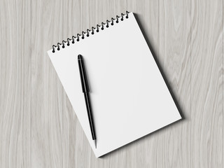 Blank note paper with pen. on wood background