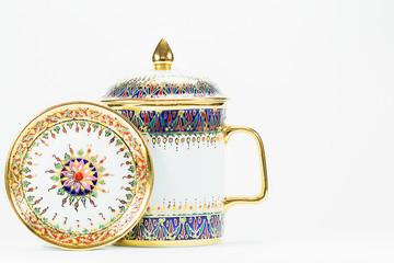 Thai antique porcelain drinking glass on white background
