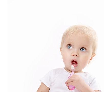little child baby brushing teeth