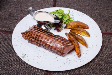 Delicious beef steak with roasted potatoes.