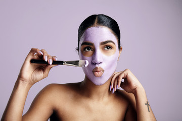 black woman have fun with a facial mask
