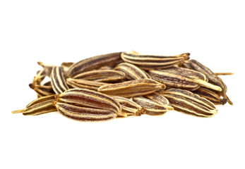 Close up of cumin seeds on white background
