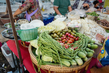 Mix vegetabel and raw for cooking Famous Thai food, papaya salad (Somtum), street food stall in Bangkok, Thailand