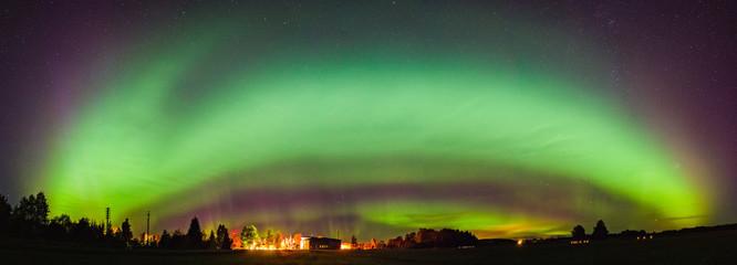 Nortern Light arc over small town