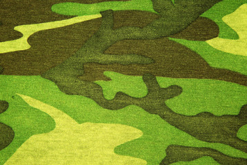 Photo of texture green camouflage material,background