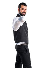 Luxury waiter pointing to the front