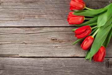 Valentine's day red tulips over wood