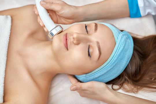 ultrasonic face cleaning, peeling, in a beauty salon