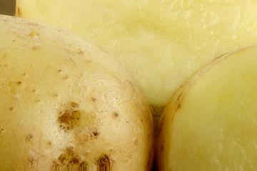 Extreme closeup of potatoes showing flesh and potato skin