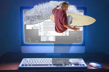 An internet web surfer is literally surfing a wave right through the computer screen with web pages and information on the screen of the computer