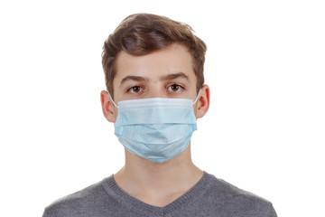 Cute sick boy in a mask