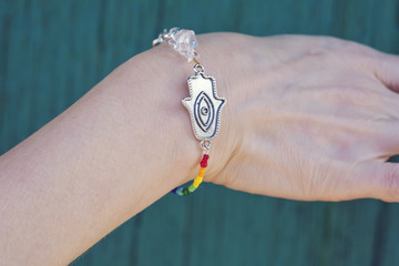 Female hand in yoga posititon with beautiful bracelet