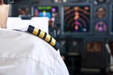 Captain epaulet - shoulder of a jet airliner pilot Fototapete