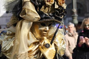 Italy, venice, carnival mask posing in san marco square