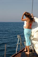 Girl enjoys boat trip on a rostrum