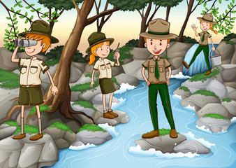 Park rangers standing at the waterfall
