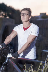 Sport and Fitness Concepts. Caucasian Male Cyclist With MTB Bike