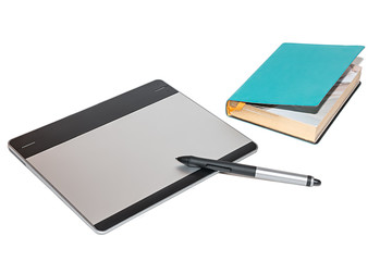 graphic tablet with pen and notebook