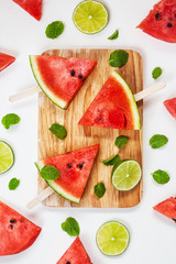 Watermelon slices on wooden stick with lime on white background
