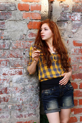 red-haired girl in a hat hipster
