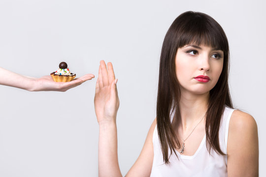 Dieting woman refusing cake