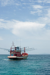 Red Fishing vessel moving at low speed