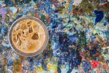 iced coffee on grunge paint poster color background