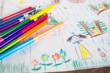 Child's drawing and colored pencils