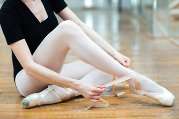 Ballerina dressing pointe shoe