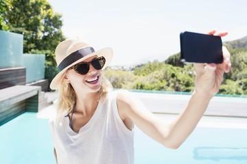 Beautiful blonde taking selfie