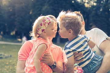 sweet childrens kissing