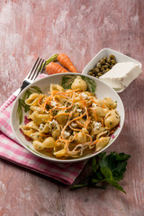 pasta with carrot capers and soft cheese