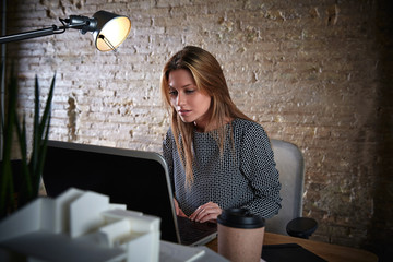 Businesswoman working with computer at office