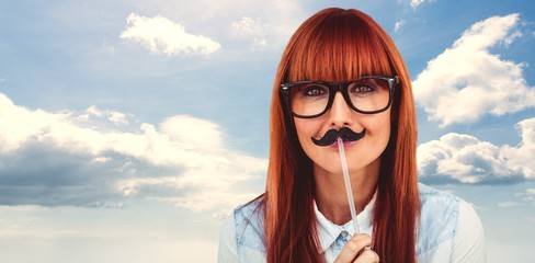 Composite image of portrait of a hipster woman with a mustache