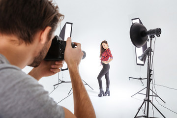 Photographer working with model in studio