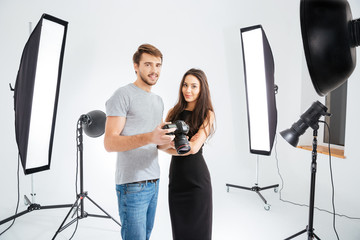 Model and photographer standing in studio