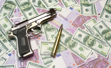 money, gun and bullets