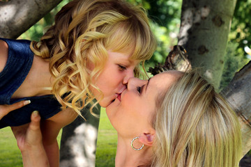 Mom and daughter Loving Kiss