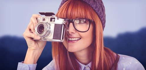 Composite image of smiling hipster woman taking pictures