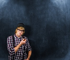 Composite image of serious blond hipster smoking a pipe