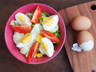 Fresh hard boiled eggs and salad with tomatoes