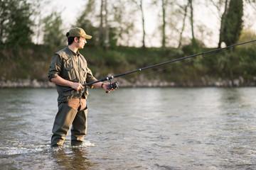 Fisherman fishing in a river