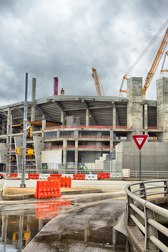 heavy construction cranes erecting concrete building